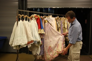 Ballet West Artistic Director Adam Sklute checking out a 'Lady in Waiting' costume.