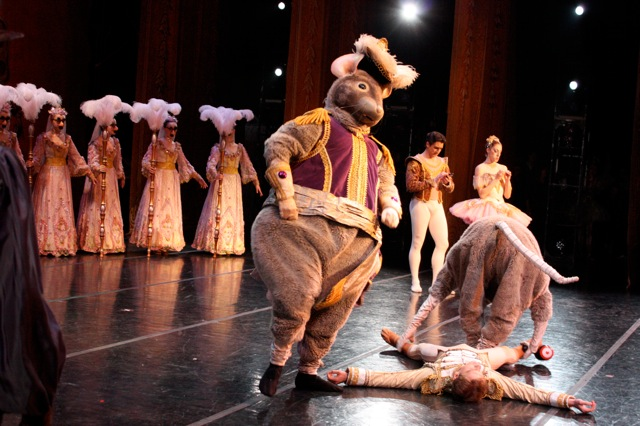 The Mouse King (Rex Tilton) Knocks out the Nutcracker Prince (Alexander McFarlan) while the bored Sugar Plum Fairy (Christiana Bennett) and her Cavalier (Christopher Ruud) take care of their nails and text messages.
