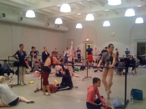 Dancers fill the studio and warm up for class
