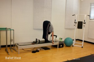 Trevor Naumann on the pilates reformer.