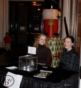 Jennifer Robinson and Kyra Smith at the donation table in the lobby of the Capitol Theatre